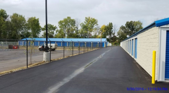 Outdoor storage units and facility fence