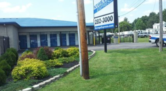 Well-kept lawn in front of storage facility